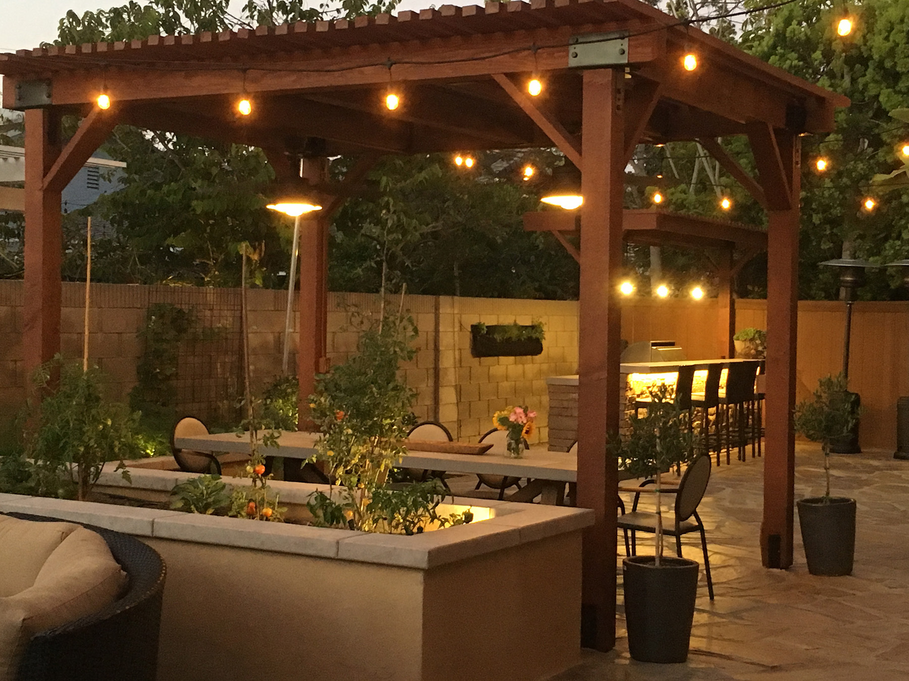 Bistro Lights with Planters and Pergola at Night